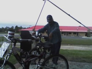 Danny working on our bikes . The motel is in the background. Across from the is the park.